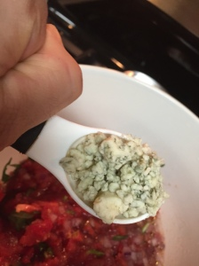 The first Tbsp of Gorgonzola being added to the salsa.
