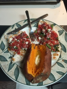 Chicken breasts topped with tomato-Gorgonzola salsa and tonight accompanying a baked sweet potato.