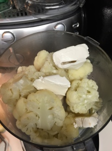 The cream cheese added to the steamed cauliflower.