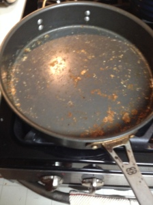 Scrape off as much of the gnocchi that has stuck to skillet and discard.