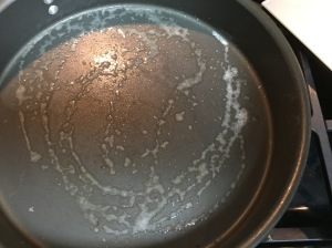 My skillet sprayed with Pam, eagerly waiting on the chicken breasts.