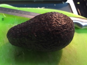 The first avocado about to go under the knife.