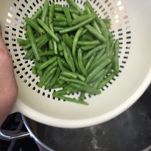 The beans have been prepared and are heading into boiling water for five minutes.