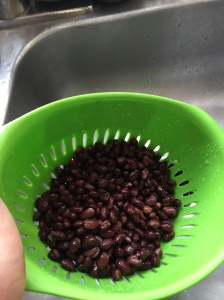 After draining the black beans, rinse well under cold water.