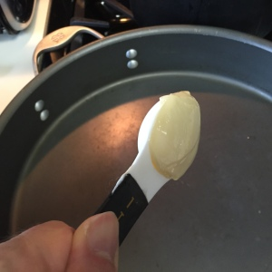 Adding the butter into heated skillet.