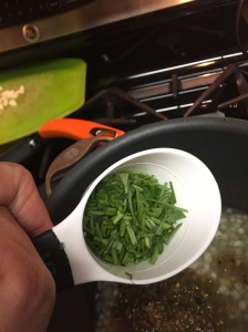 The cilantro stems about to hit the pan.
