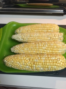 The cobs of corn awaiting their fate.