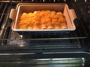 Topped with the cheese, the tortillas are placed in the oven under the broiler.