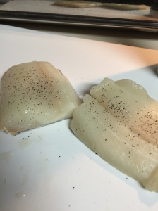 The halibut fillets seasoned with salt and pepper.