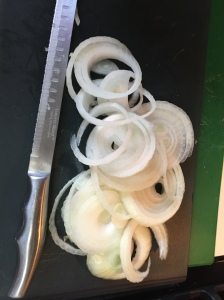 Here is the onion, peeled and thinly sliced.