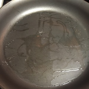both Tbs of canola oil have coated the skillet.