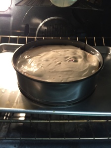 Freshly topped, the cheesecake  goes back in the oven for a final five minutes of baking.