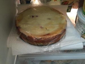 Wrapped lightly in plastic wrap, the cheesecake goes into the fridge for at least eight hours before being ready to serve.