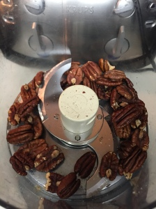 The toasted walnuts transferred to food processor.