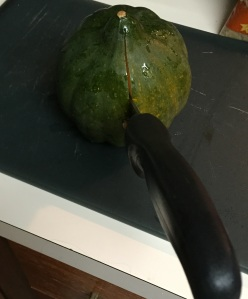 I started cutting from the bottom of the acorn squash (opposite from the stem side).