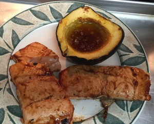 Here is one of the acorn squash halves plated with   salmon.