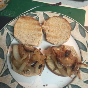 The caramelized onions, divided and covering the bun bottoms.