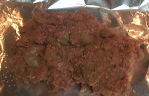 Start by plopping the meatloaf mixture on the baking sheet.