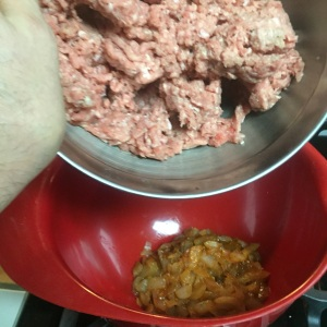 In goes the ground turkey.
