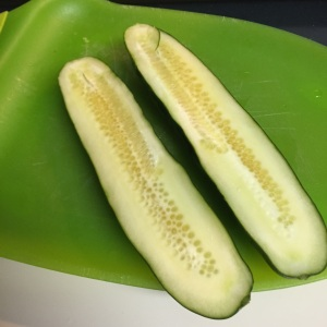 The cucumber cut in half.