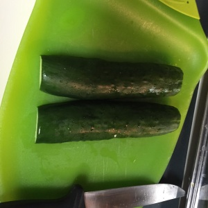 Flip over the cucumber halves so that they are faced down.