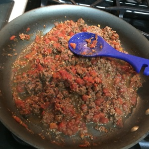 The ground beef and tomato mixture is ready to go into a flatbread taco!