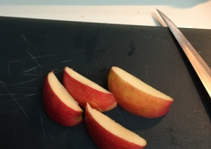 Half of the apple in sections, ready to be thinly sliced.