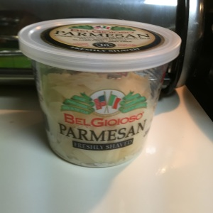 A container of shaved Parmesan.