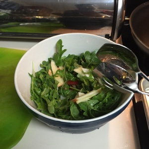 The arugula salad, after a good tossing ahead of the vinaigrette being introduced.