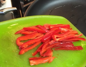 And into the pan go the bell pepper slices!