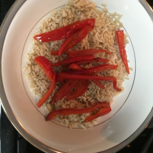 Add the bell pepper slices on top of the rice in the bowl.