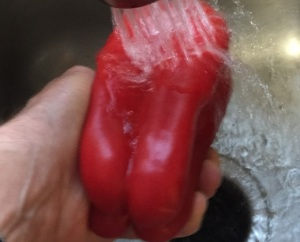 Give the bell pepper a good washing.