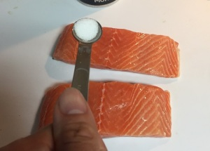 About to salt the salmon.