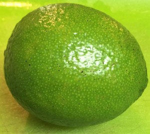 Cut a medium-sized ripe lime in half.